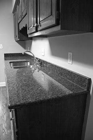 quartz kitchen countertop and wood cabinets